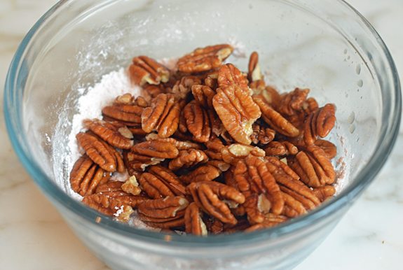 adding-pecans-to-sugar