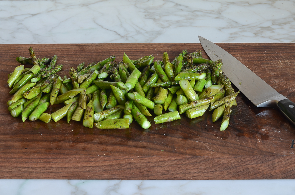 cutting grilled asparagus