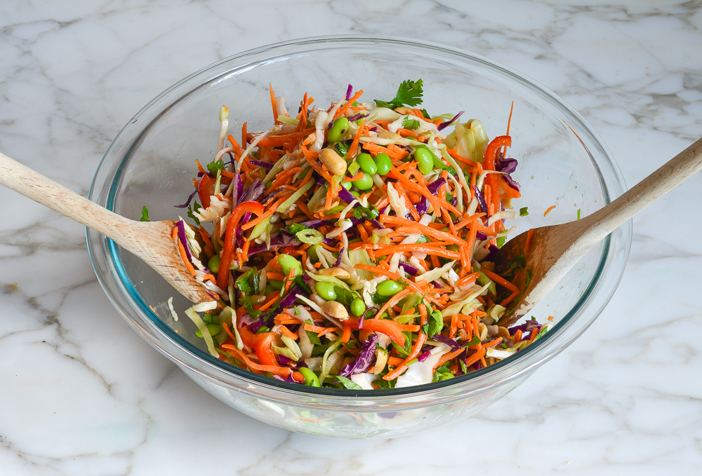 tossing Asian slaw with dressing