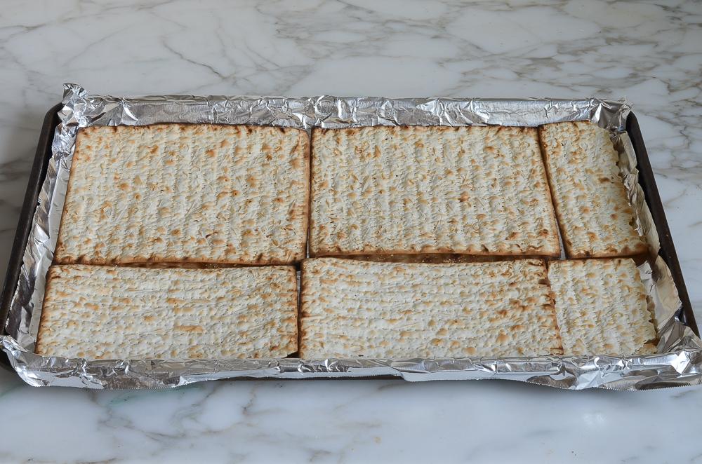 matzo arranged on baking sheet