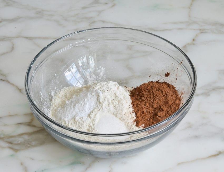 making chocolate banana bread -- flour, cocoa powder, baking soda, and salt in a mixing bowl
