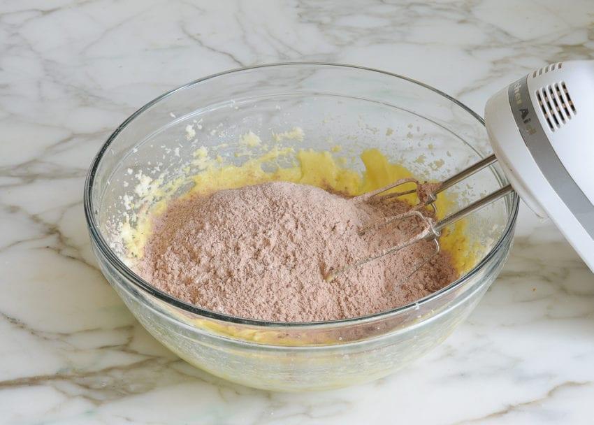 making chocolate banana bread -- adding dry ingredients to wet ingredients