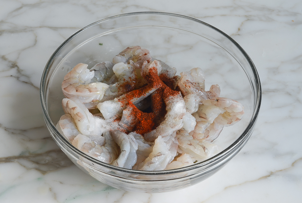 shrimp in bowl with seasoning and oil