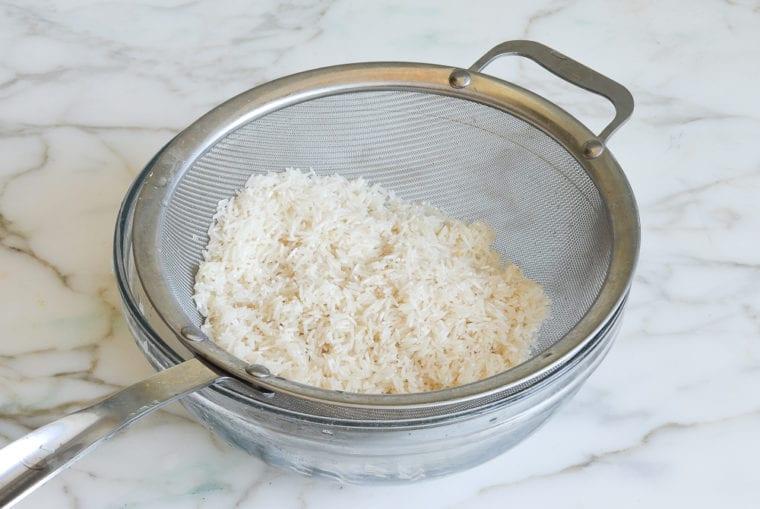 draining basmati rice