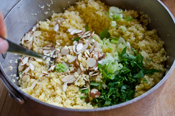stirring-in-herbs-scallions-and-nuts
