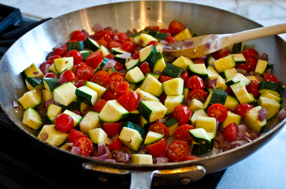 adding-zucchini-and-tomatoes