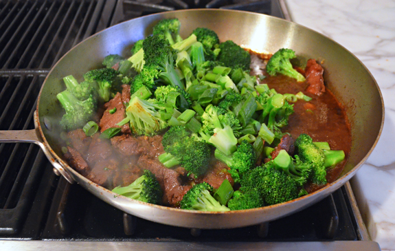 adding-cooked-broccoli-beef-and-sauce