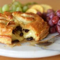 Baked Brie en Croûte with Honey, Dried Cherries, Rosemary & Pecans