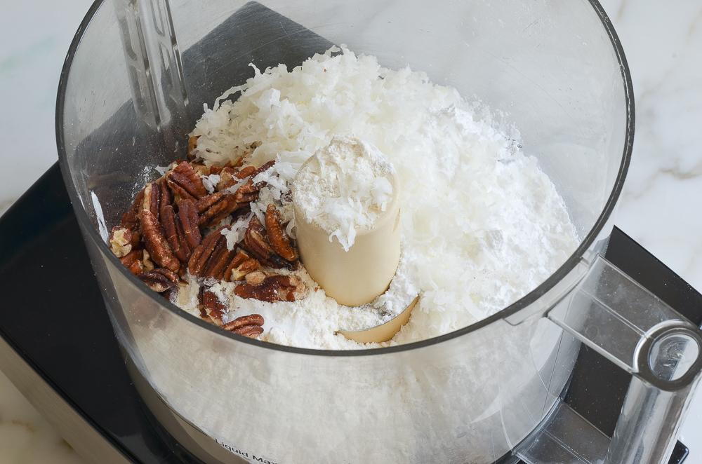 coconut, pecans, flour, sugar in bowl of food processor