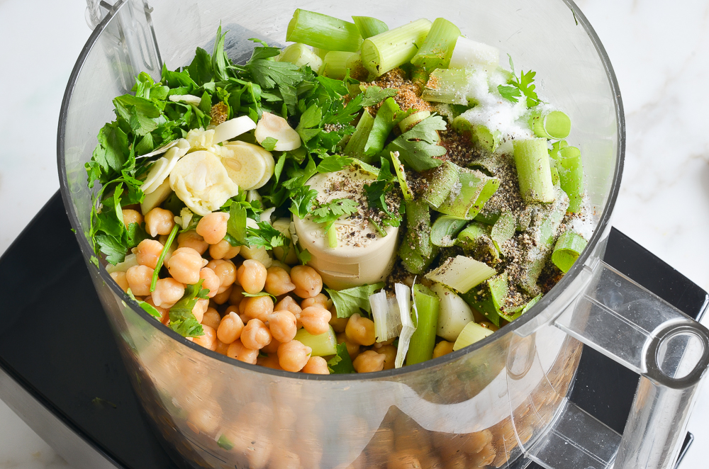 chickpeas and other ingredients for falafel in food processor