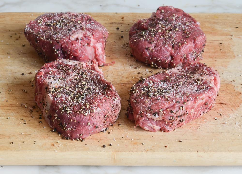 seasoning the steaks