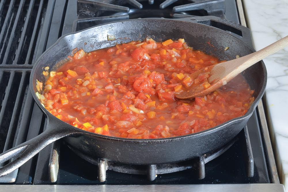 Simmering shakshuka sauce