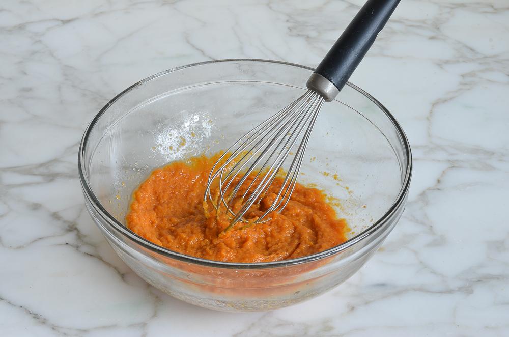mixing pumpkin puree and butter for pumpkin pancakes