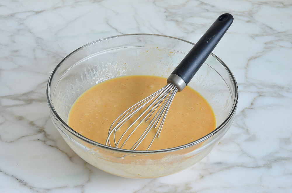 wet ingredients in a mixing bowl for pumpkin pancakes
