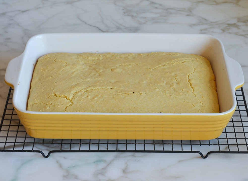baked cornbread cooling on rack