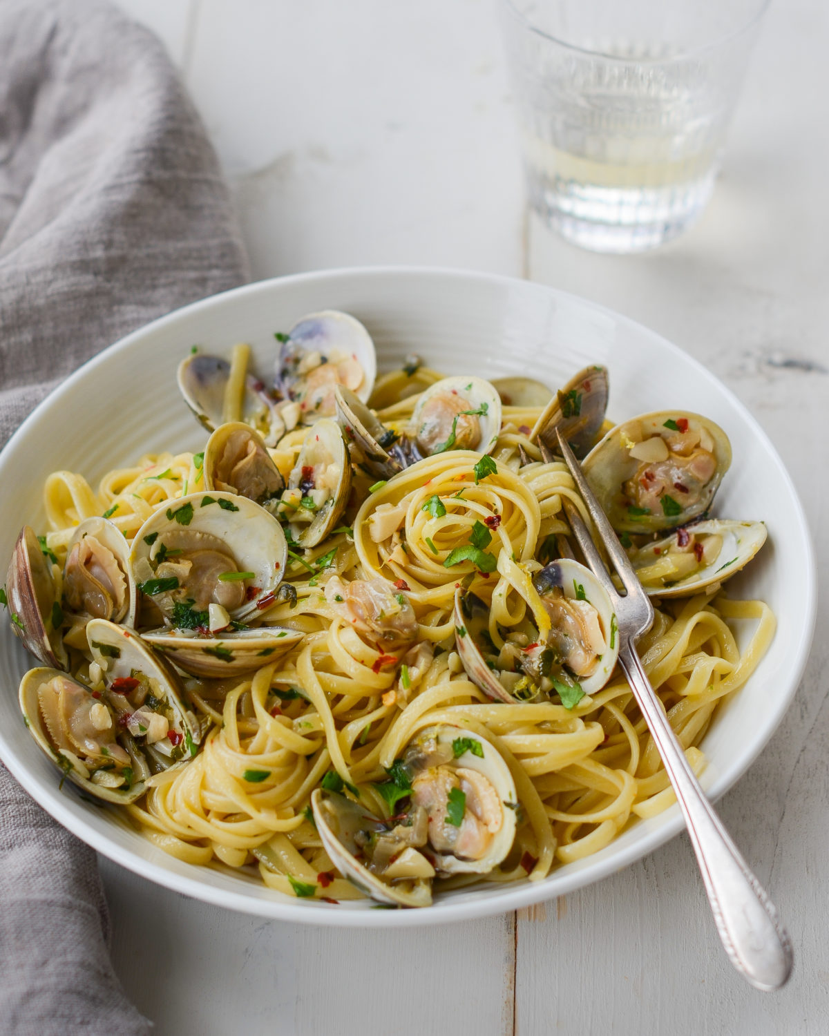linguini with clams in bowl