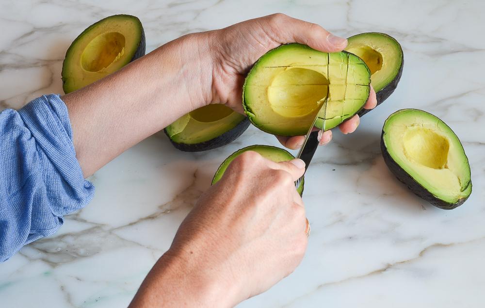cutting a grid in the avocado flesh