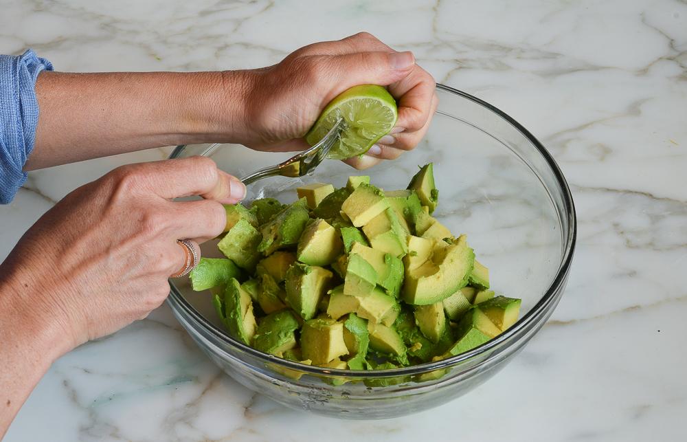 squeezing lime over avocado