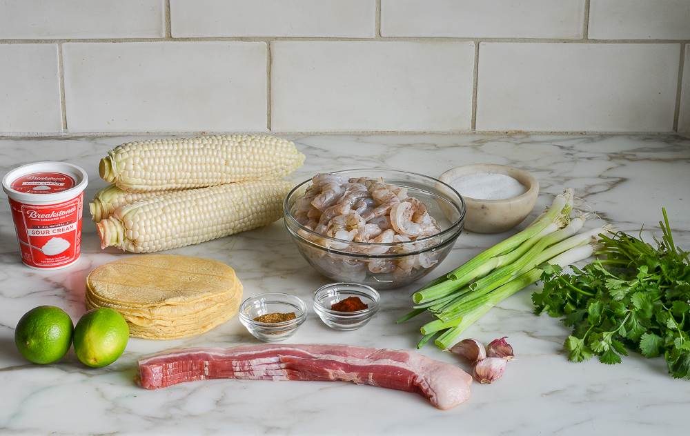ingredients for shrimp tacos with corn, bacon and lime crema