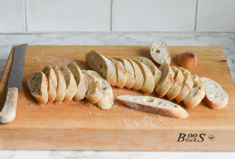 slicing the baguette for bruschetta