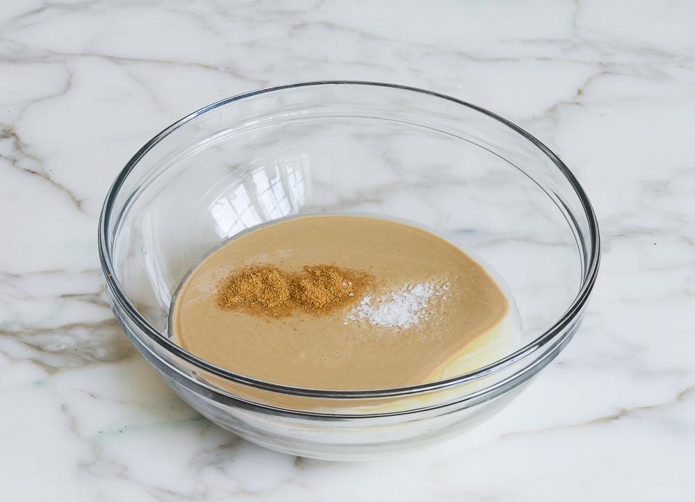 lemon mixture, tahini, cumin and salt in mixing bowl