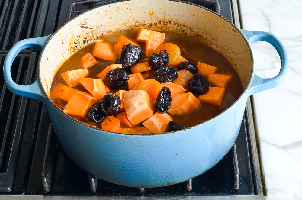 adding the sweet potatoes and prunes