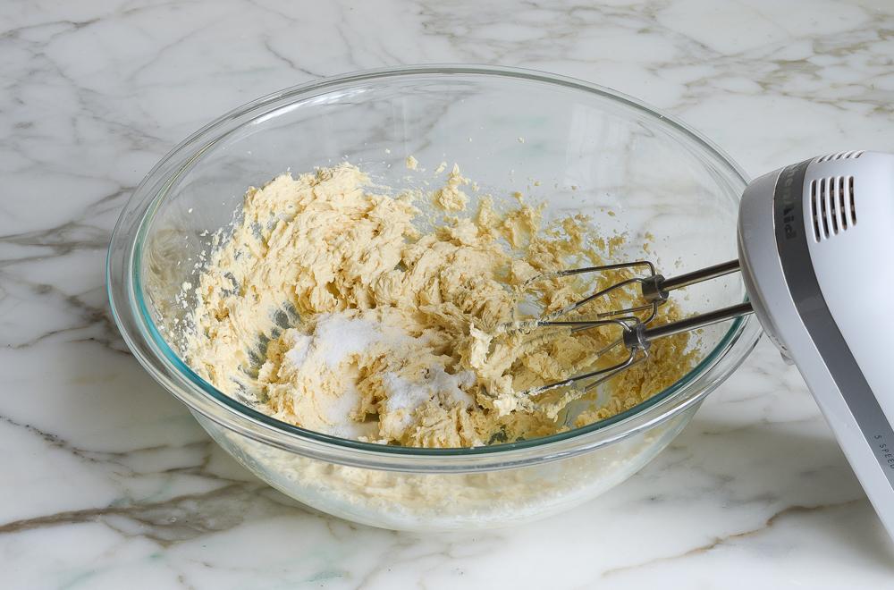 mixing in salt, baking powder, and baking soda