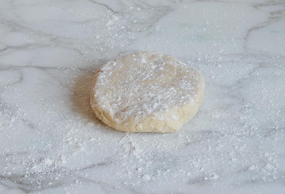 pie crust dough on floured work surface