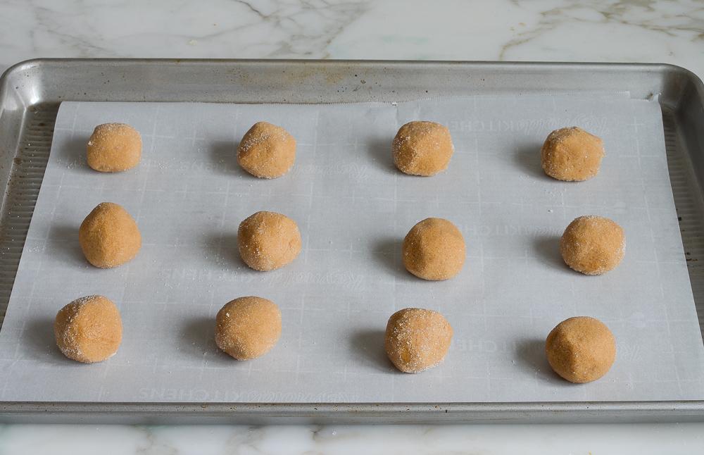 dough balls on baking sheet