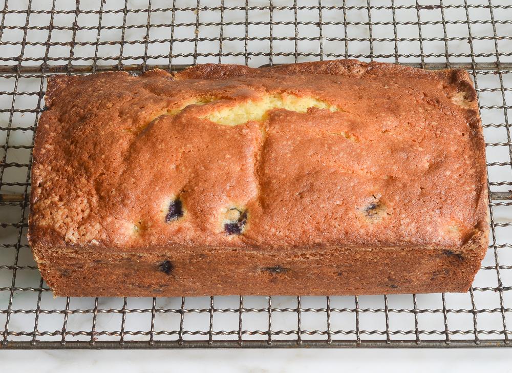 lemon blueberry pound cake cooling on rack