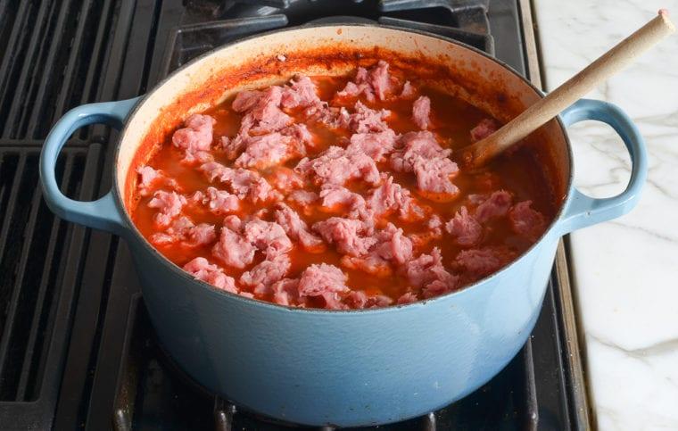 adding the remaining turkey to the chili