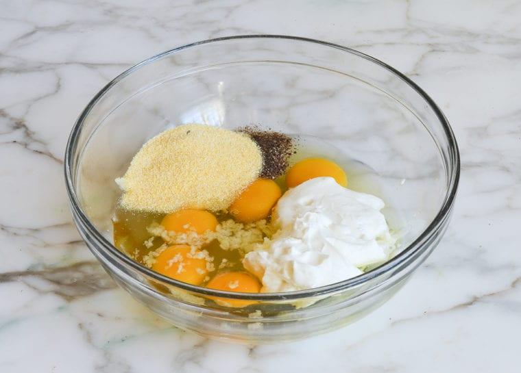 eggs, yogurt, and polenta in mixing bowl