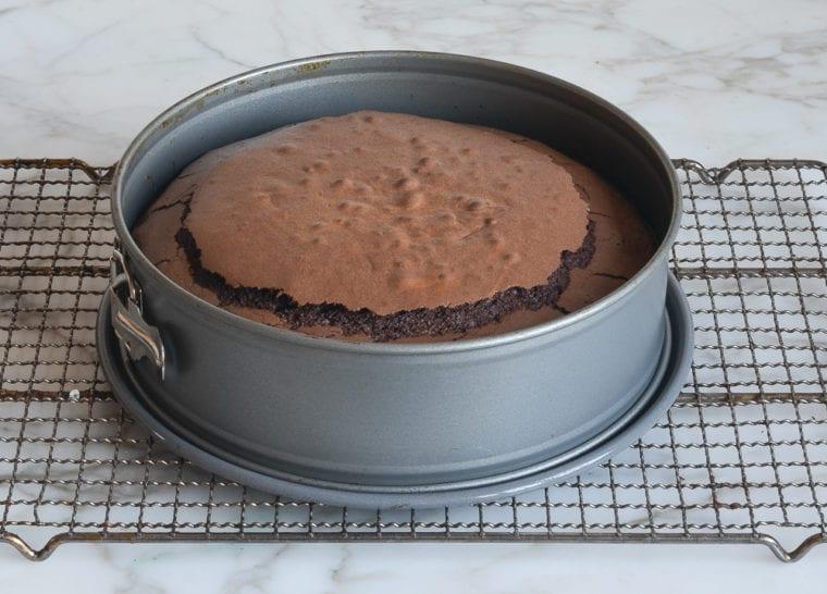 baked flourless chocolate cake on rack