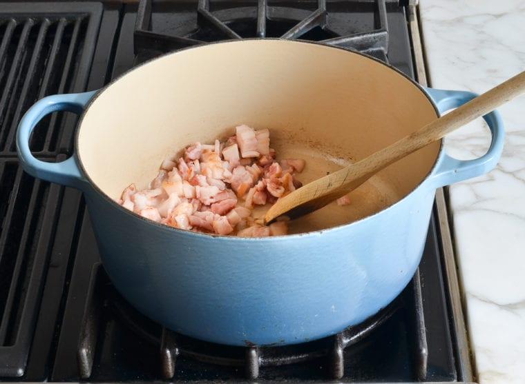 adding bacon to pot