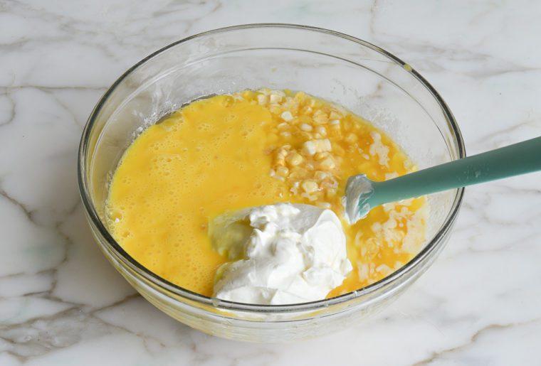 adding sour cream and beaten eggs