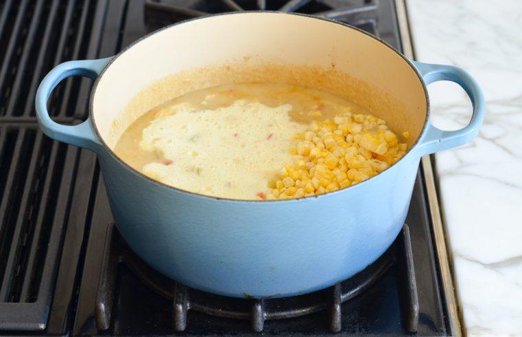 adding corn puree and fresh corn to chowder